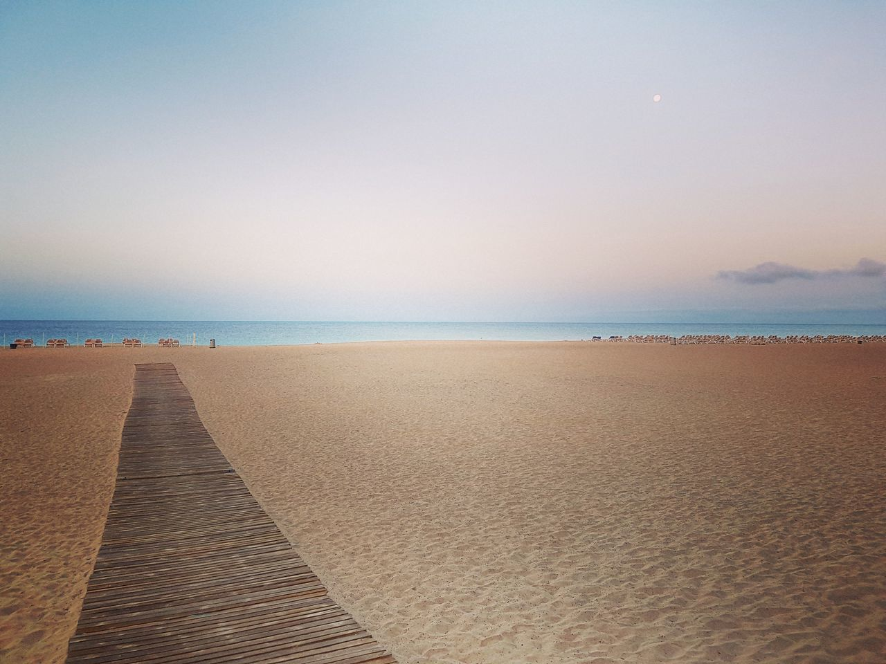 Beach Sand Sea Outdoors Horizon Over Water Water Sky Tranquility Vacations Travel Destinations Day Summer Sand Dune Nature Scenics No People Beauty In Nature Wave Moonset