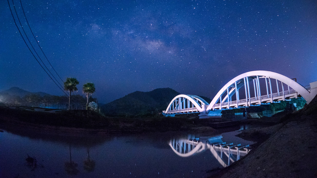 Tha Chomphu Bridge, Tha Pla Duk, Lamphun, Thailand Architecture Arrival Astronomy Blue Bridge - Man Made Structure City Landscape Milky Way Milkyway Night Night Lights Night Photography Nightphotography No People Outdoors Railway Scenics Sky Star Star - Space Thailand Travel Travel Destinations Vacations Water