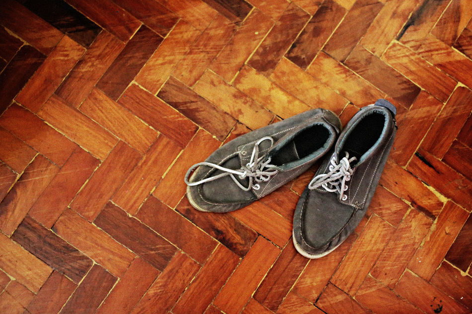 worn out. Boots Day Directly Above Gray Hardwood Floor High Angle View Indoors  Lieblingsteil No People Old Pair Shoe Wood - Material Worn Out
