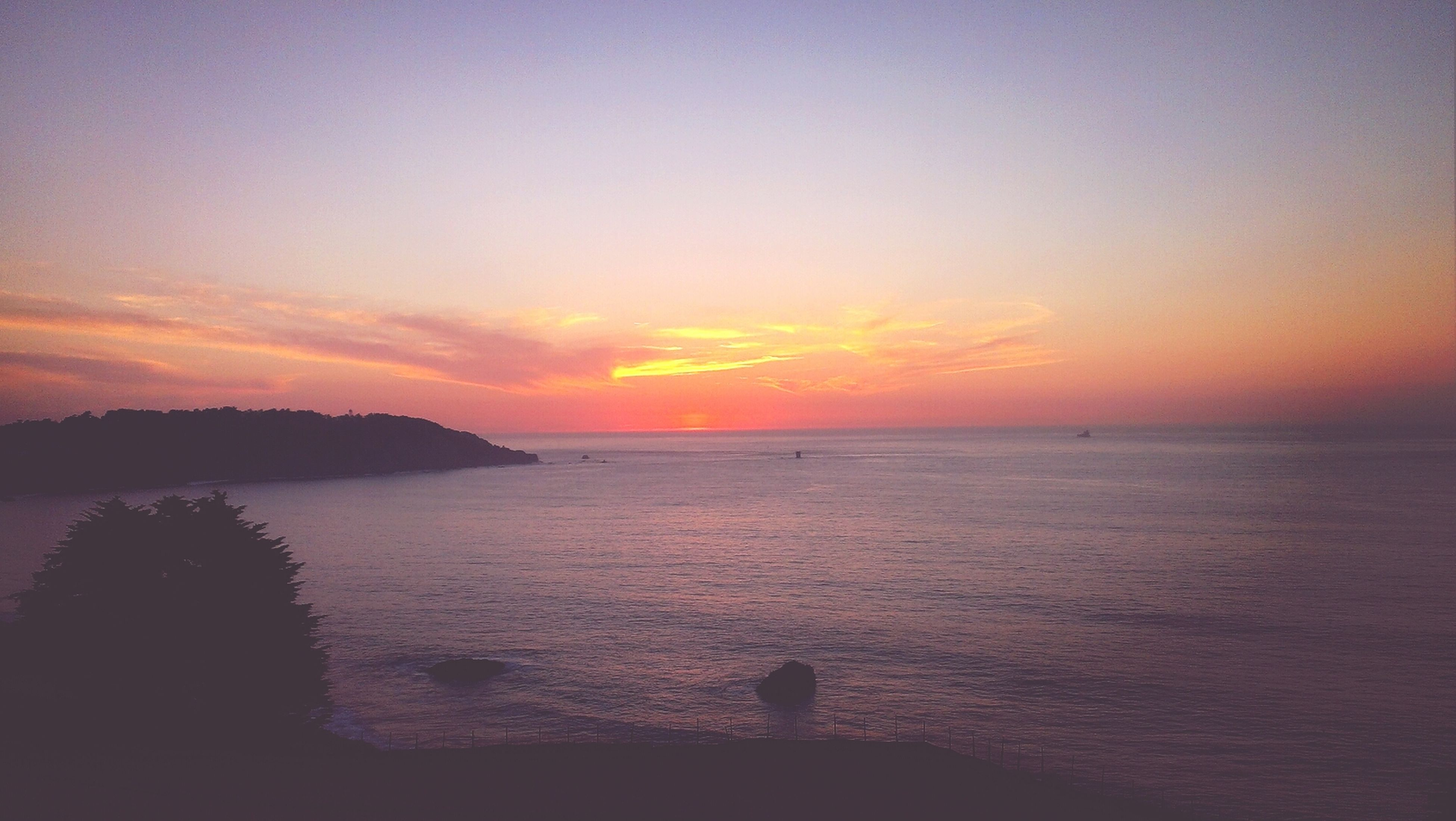 sunset, sea, water, scenics, tranquil scene, horizon over water, tranquility, beauty in nature, silhouette, orange color, sky, idyllic, nature, beach, shore, remote, dusk, outdoors, calm, non-urban scene