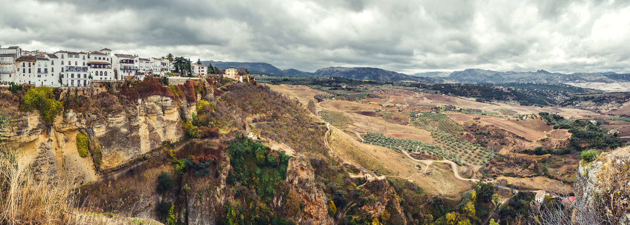 Panoramic view of old city of Ronda and surrounding countryside. Province of Malaga, Andalusia, Spain Aerial View Ancient Architecture Andalusia Beauty In Nature Cliff Cloud - Sky Costa Del Sol Day Famous Place Landmark Landscape Malaga Mountain Mountains Nature Outdoors Panorama Picturesque Village Rocky Mountains Ronda Spain Scenics SPAIN Town Travel Destinations Village