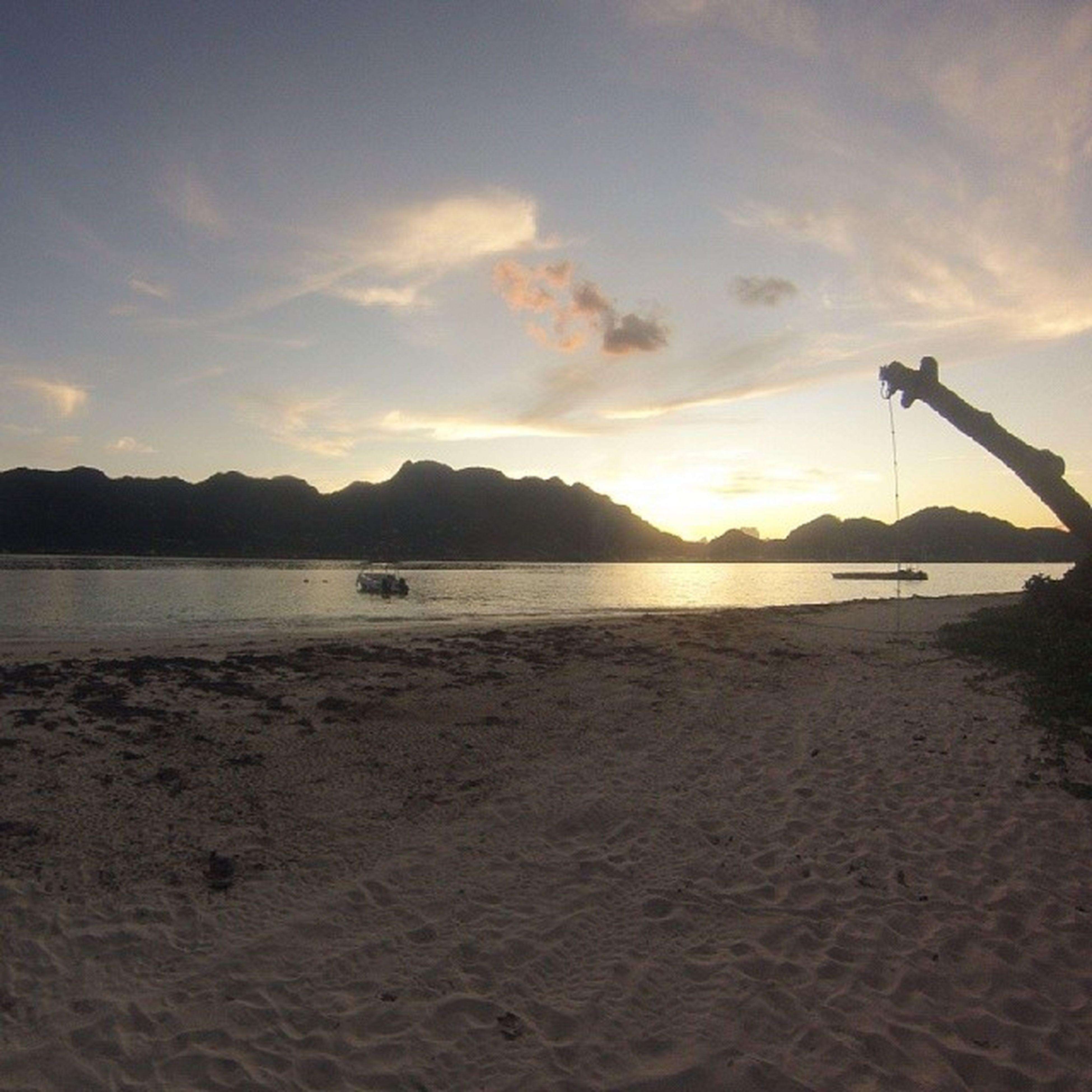 sunset, water, sky, tranquil scene, scenics, tranquility, beauty in nature, sea, mountain, beach, silhouette, sun, nature, idyllic, cloud - sky, shore, orange color, sunlight, cloud, lake