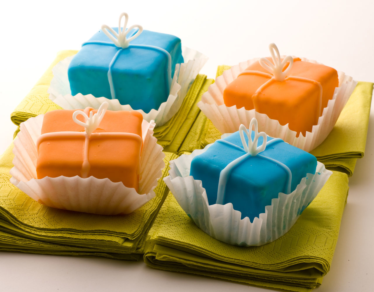 Small desserts Birthday Present Blue Celebration Celebration Event Christmas Christmas Present Close-up Decorations Desserts Four Gift Napkin No People Petite Petite Fours Red Sunset Sweets Tied Bow White Background Wrapped Wrapping Paper