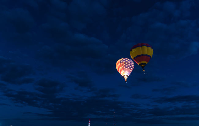 Albuquerque Albuquerqueballoonfiesta Balloon Balloonfiesta  Beauty In Nature Blue Cloud Cloud - Sky Cloudy Colorful Dramatic Sky Fiesta Flying Hot Air Balloon Hot Air Balloons Hotairballoon International Balloon Fiesta Low Angle View Mid-air Multi Colored Outdoors Tranquil Scene Overnight Success