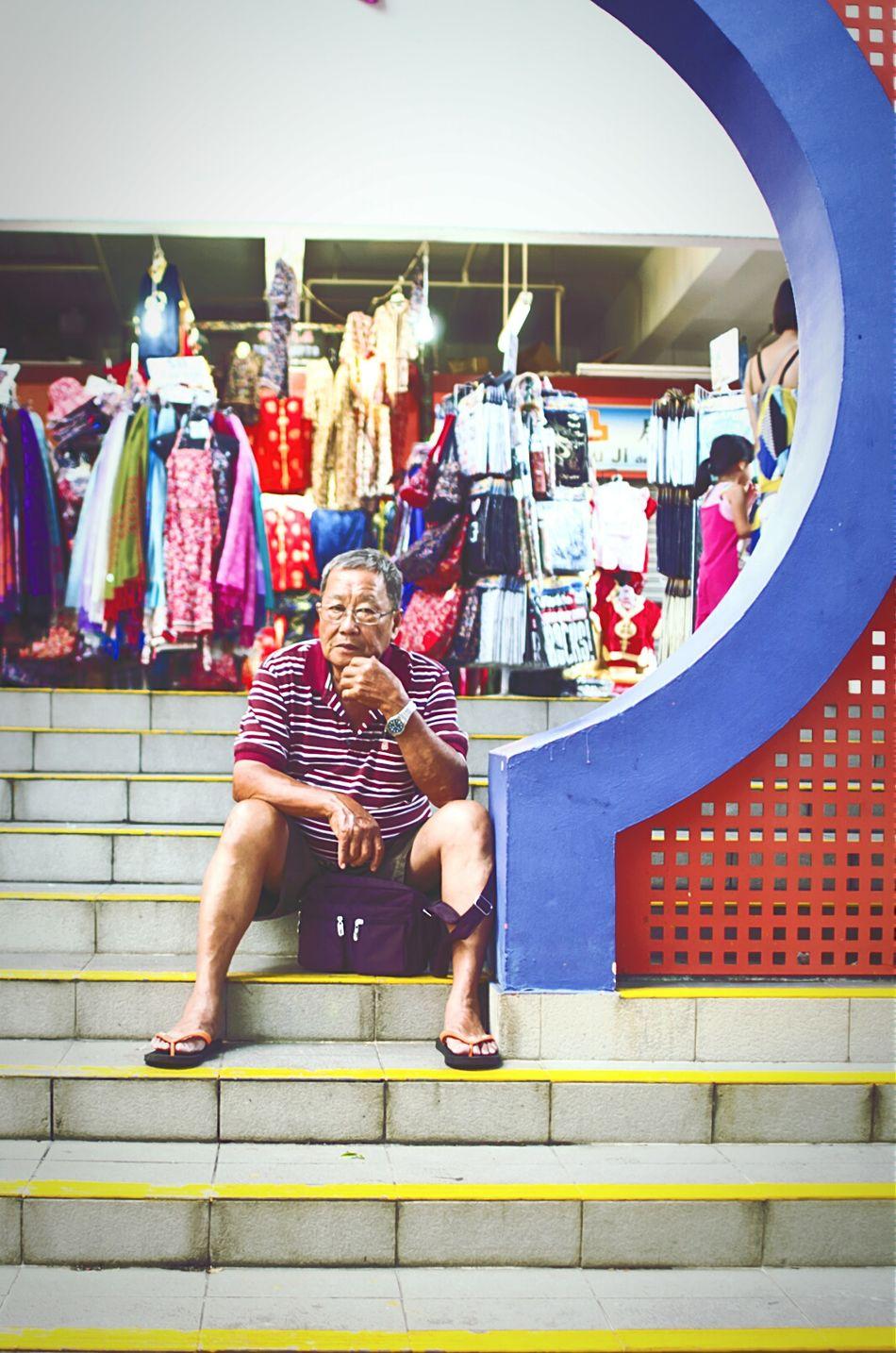 a question hangs over him EyeEm , EyeEmChinatownPhotowalk , Streetphotography , Moongate , Bystander , Market ,