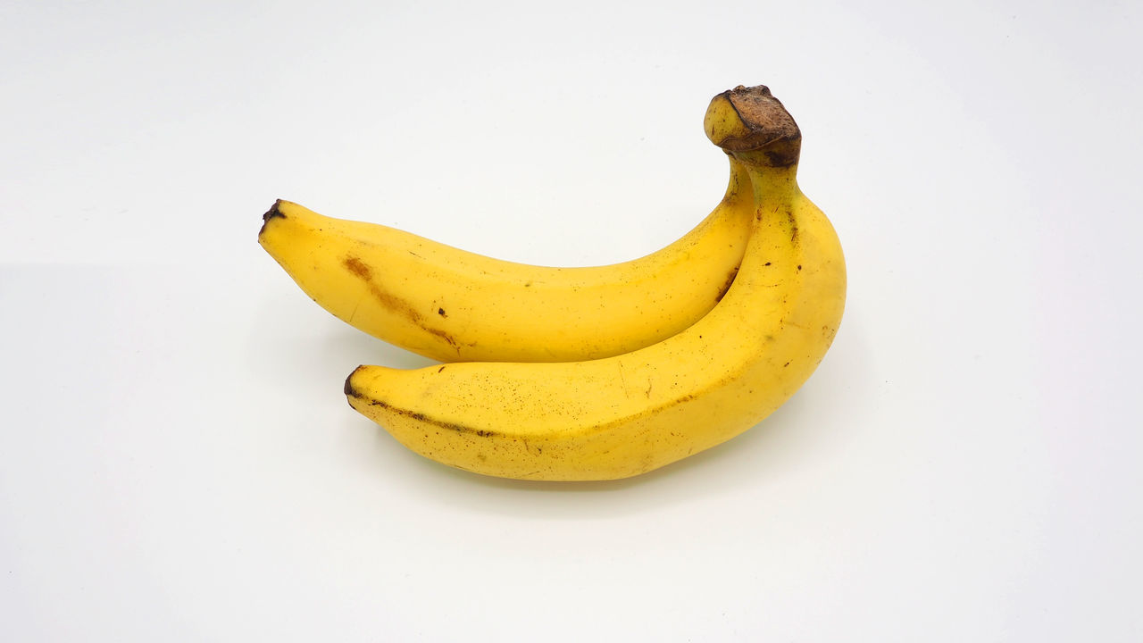 Real two yellow banana no retouch and white background and isolated. Banana Banana Peel Banana; Isolated; White; Background; Bananas; Ripe; Yellow; Food; Healthy; Closeup; Fresh; Fruit; Skin; Diet; Snack; Macro; Tropical; Vitamin; Appetizing; Peel; Flesh; Path; Bananasfruit; Bright; Sweet; Tasty; Two; Natural; Object; Bunch; Real; No Retouch Food Food And Drink Freshness Fruit Healthy Eating No People White Background Yellow
