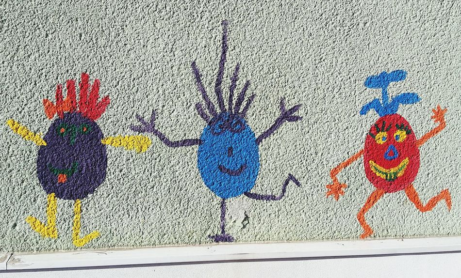 Three funny guys painted on a wall Multi Colored No People Outdoors Close-up Day Wall Colorful Colors Funny Children's Painting Egg Men Eggs Variation Drawing - Art Product Full Frame Creativity Art And Craft Three Three Objects