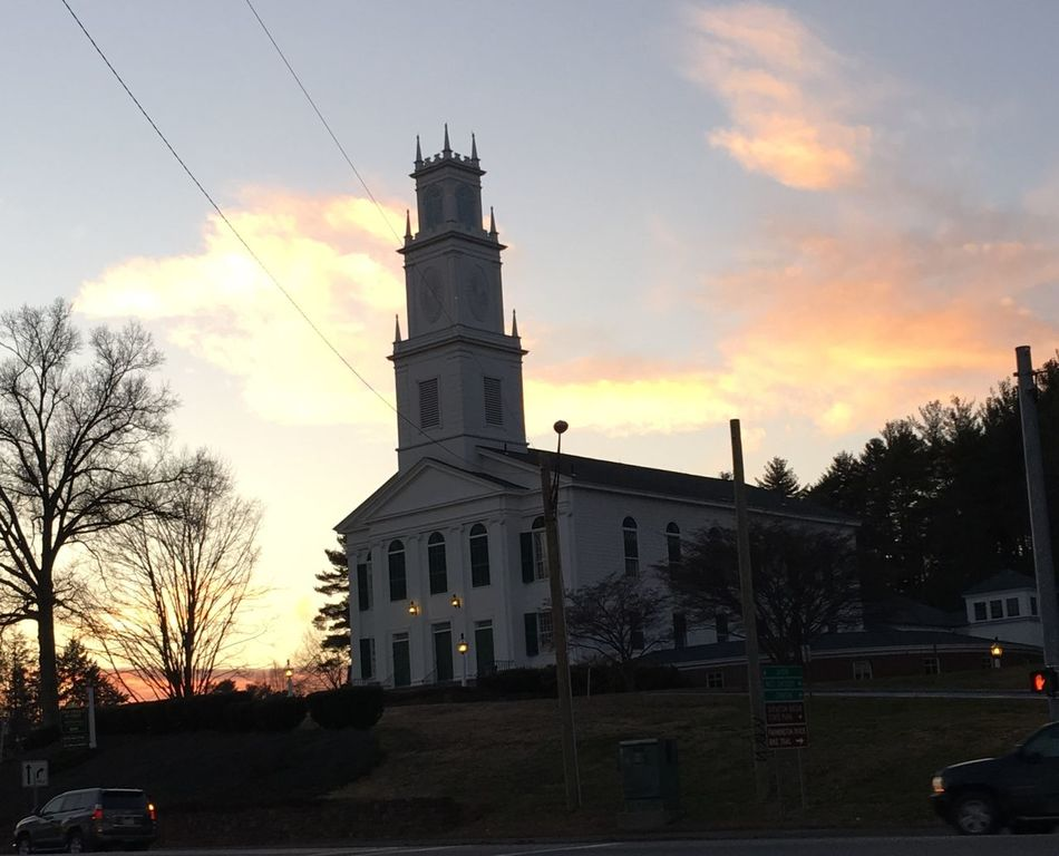 First Church framed in sunsets glow...