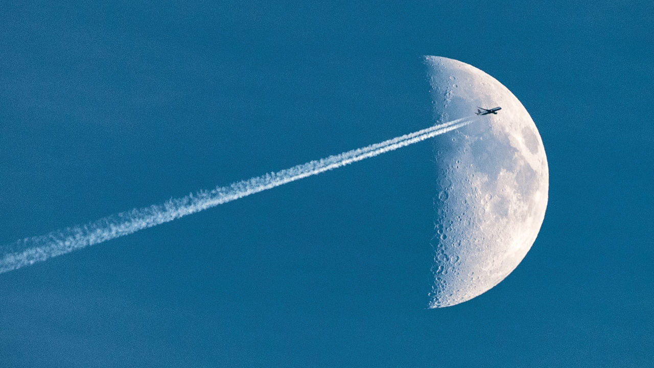 """""""Fly me to the moon..."""" 16x9 Air Travel  Air Vehicle Airplane Blue Contrail Copy Space Day Flying Holidays Moon Moonlight Nature No People Outdoors Sky Travel Vacations Vapor Trail Flying High Minimalism"""