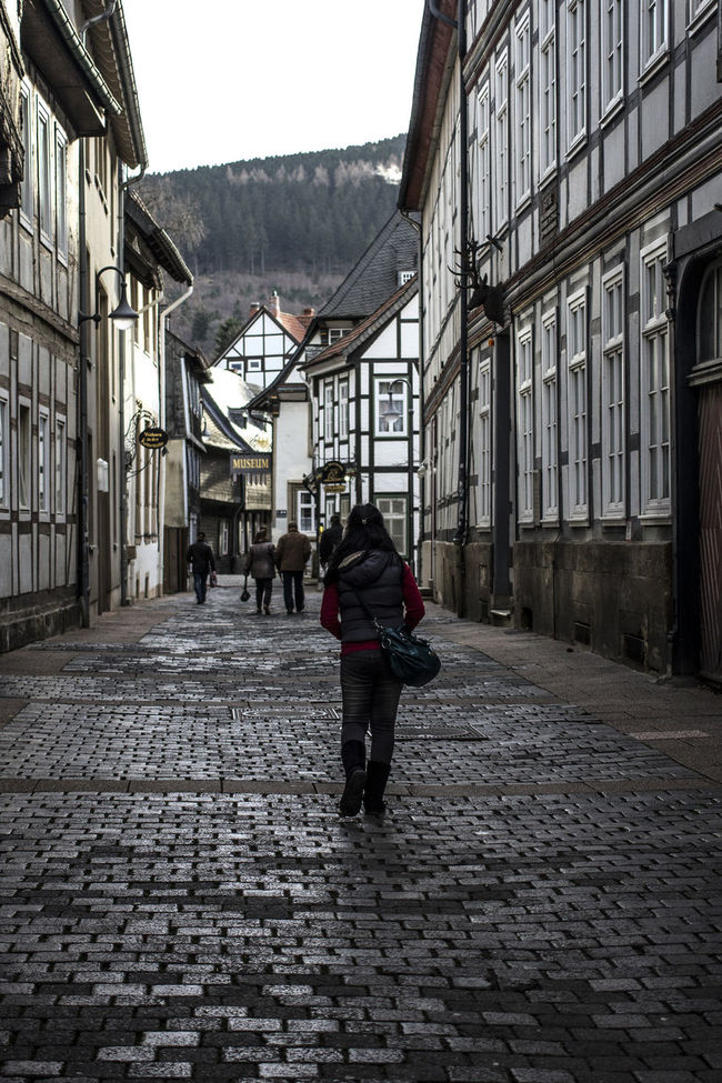 Architecture Building Exterior Built Structure Casual Clothing City City Life Cobblestone Day Full Length Germany Goslar Goslar Germany Lifestyles Men Old Town Paving Stone Person Rear View Street The Way Forward Tourism Walking