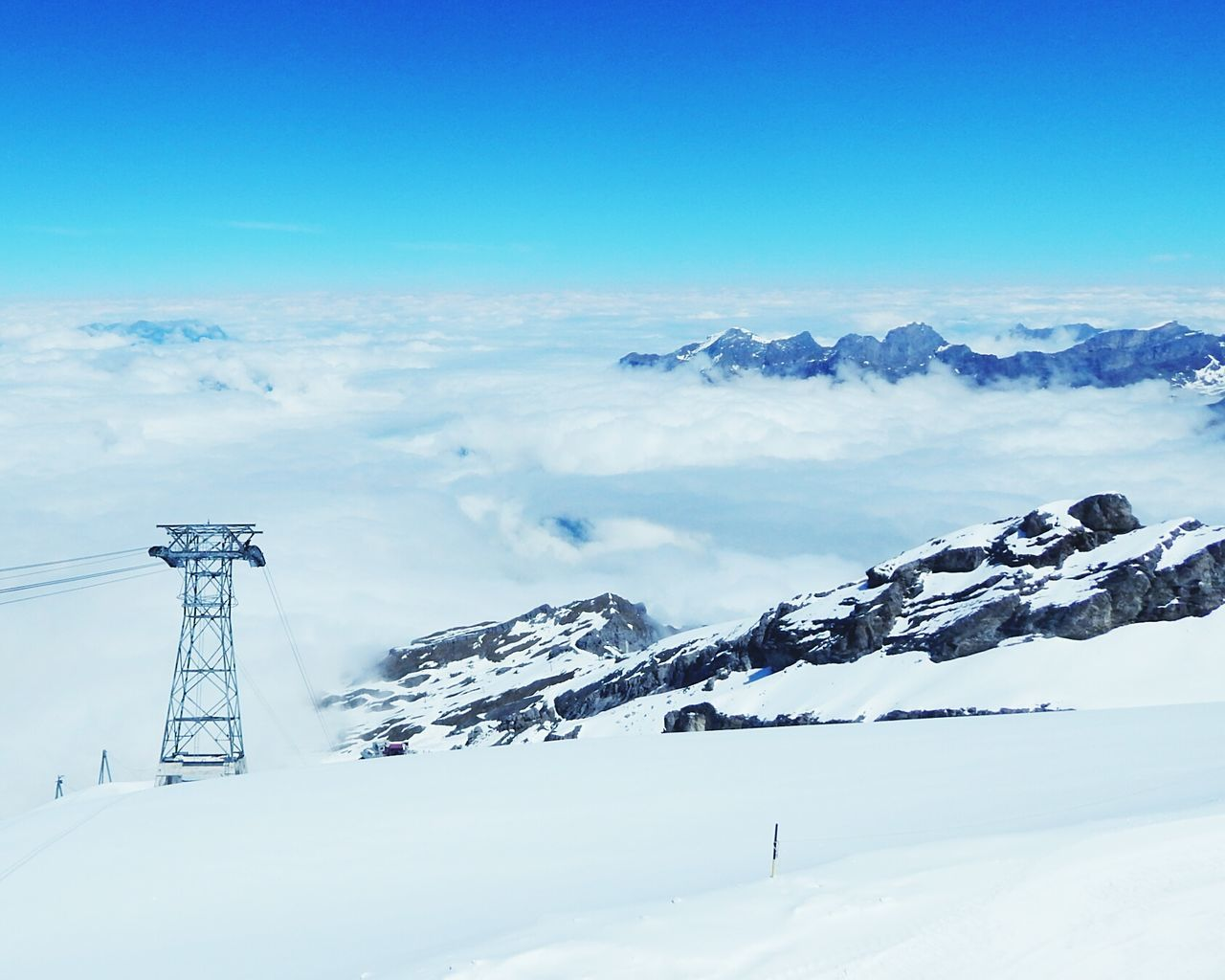 Minimalistic Travel Blue No People Sky Snow Day Landscape Scenics Nature Mountain Peak Swiss Alps Switzerland Cold Temperature Low Angle View Cloud - Sky Clouds Cloudscape