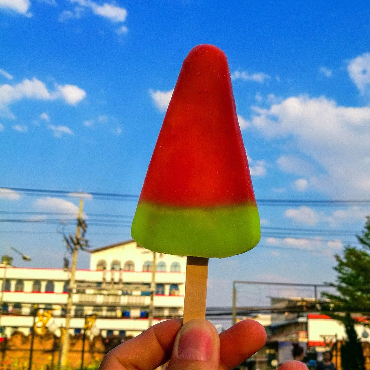human hand, human body part, sky, human finger, personal perspective, cloud - sky, holding, one person, unrecognizable person, day, outdoors, real people, close-up, red, frozen food, ice cream, flavored ice, people