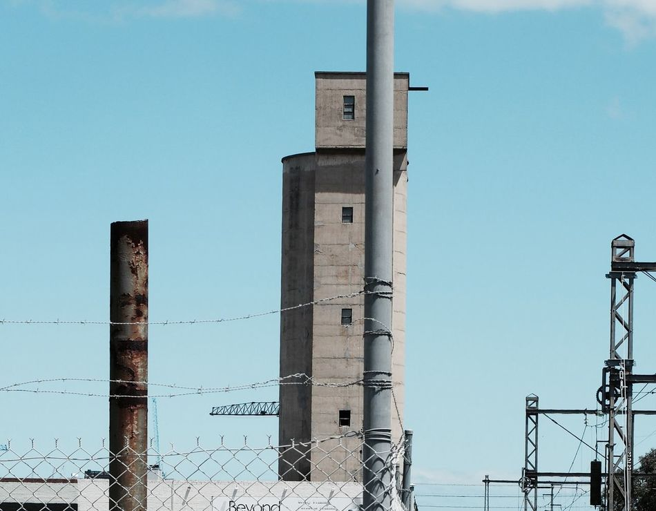 Silo Barbed Wire Cyclone Fence Blue Sky Concrete Train Line Power Lines Rust Rusty Pole Industrial Industrial Landscapes Industry City Life City Inner Suburbs Dry