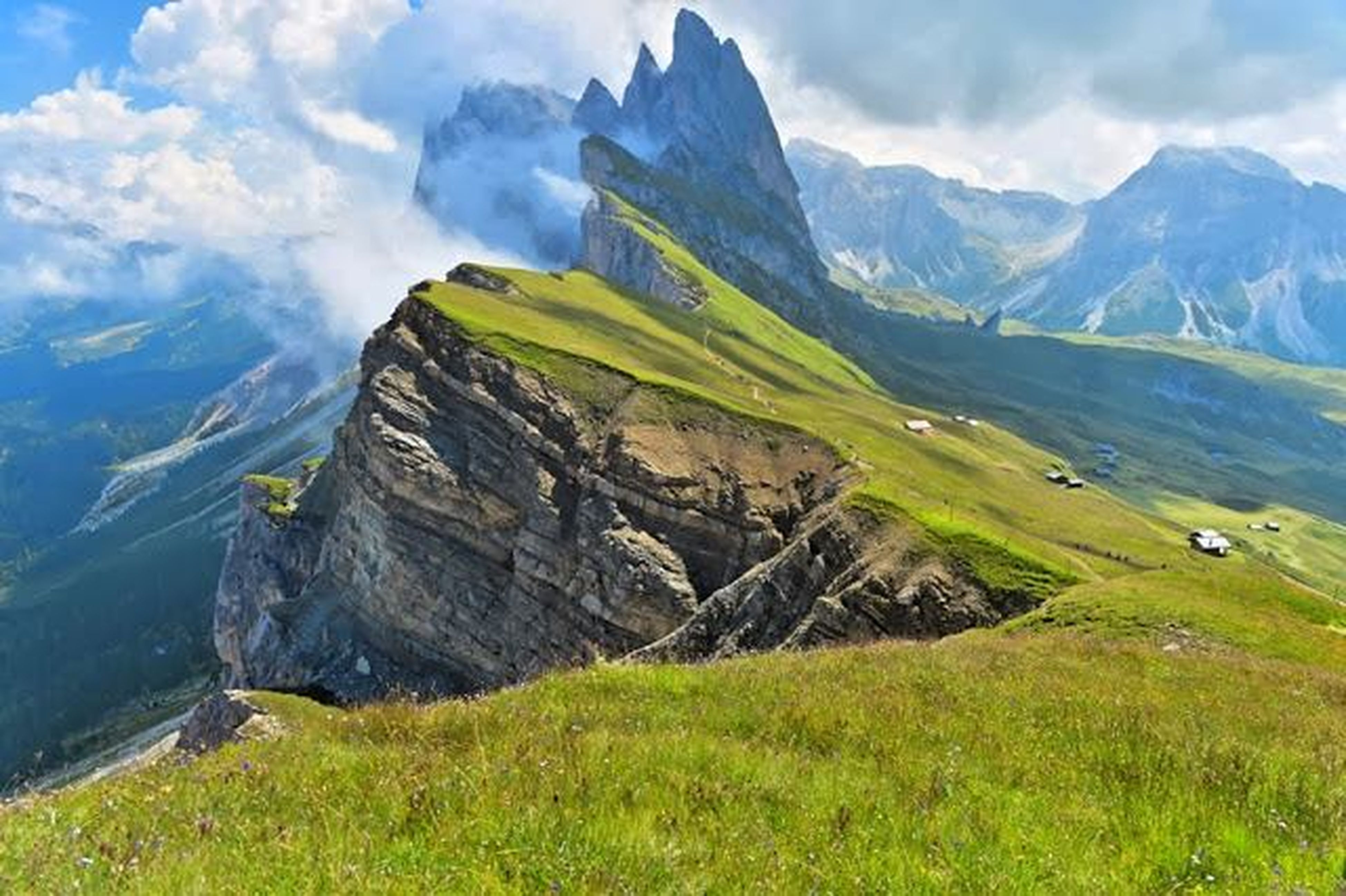 mountain, sky, grass, mountain range, tranquil scene, landscape, tranquility, scenics, cloud - sky, beauty in nature, nature, cloud, non-urban scene, cloudy, water, idyllic, day, remote, rock - object, physical geography