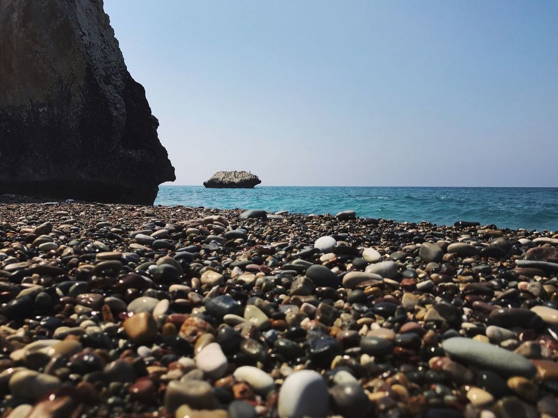 Sea Horizon Over Water Rock - Object Nature Water Shore Scenics Beauty In Nature Tranquil Scene Beach Clear Sky Tranquility Pebble Pebble Beach Day Outdoors No People Sky Fresh On Market 2017