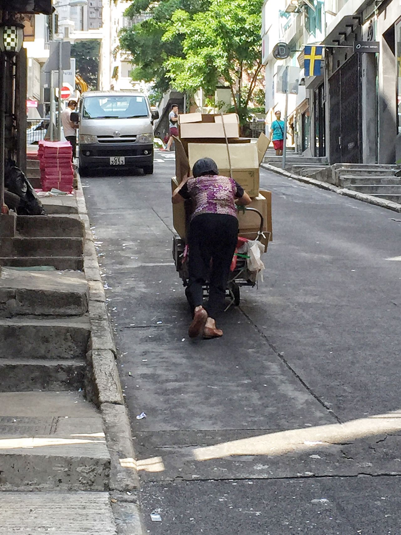 I admired this strong older woman pushing a cart up the road along Aberdeen Street in Central HongKong. This is just an ordinary sight in HongKong and I almost helped her Street City Women Around The World Woman Power Woman At Work WomaninBusiness Woman Of EyeEm The Street Photographer - 2017 EyeEm Awards Eyeemphotography Eyeem Market Eyeem Photography