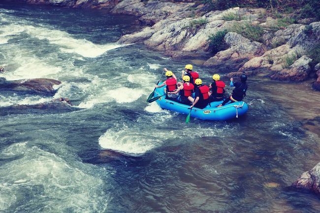 Water rafting activity on weekend The Great Outdoors With Adobe Moments Riverside Advanture Extreme Sports Hobby Quality Time Enjoyment Fun Boat Teamwork Leadership Success Starting Line Water Rafting
