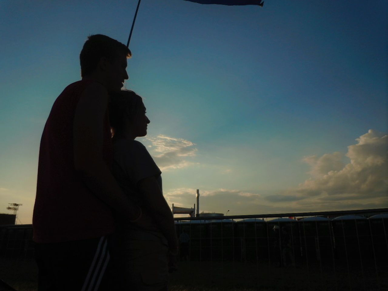 sky, two people, standing, outdoors, leisure activity, side view, togetherness, silhouette, real people, cloud - sky, lifestyles, sunset, men, day, adult, people