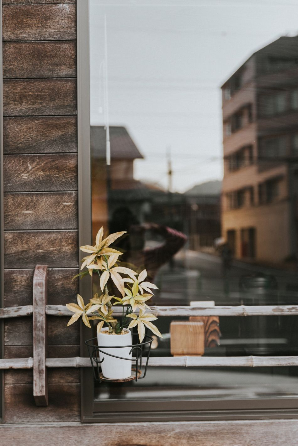 Memories of Japan ❤️ Window Sill Window Building Exterior Architecture Wood - Material Wood Portrait Of A Woman Focus On Foreground Travel Photography EyeEm Best Shots Façade EyeEmBestPics Built Structure Urban Exploration Eyem Best Shots