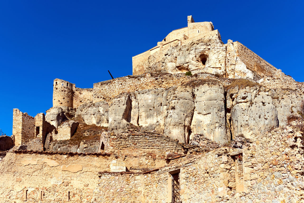 Castle of Morella, province of Castellon, Valencian Community, Spain. Morella Castle was declared a monument of artistic and historical importance. Ancient Architecture Arabic Architecture Blue Sky Castellón Castle Day Defensive Europe Fortification Gothic Architecture Heritage Building History Landmark Maestrazgo Medieval Architecture Monument Morella Nobody Outdoors Ruined Castle Skyline SPAIN Stone Sunny Day Travel Destinations