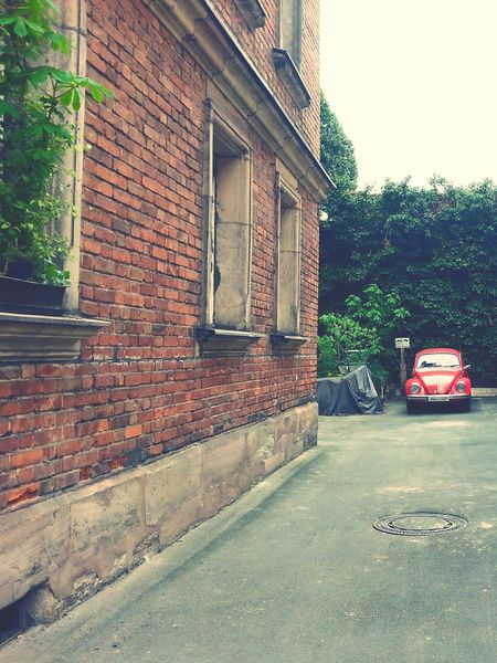 red car 🚗 Architecture Building Exterior Built Structure Protection Day Outdoors Tree No People Sky Red Color Car Beatle Red Car Vw Bug EyeEmNewHere Idyllic Scenery Backyard Photography Accent Color Focus On Background Car Photography Oldtimer Urbanphotography Urban Photography Urban Exploration The Secret Spaces The Street Photographer - 2017 EyeEm Awards BYOPaper! Mobility In Mega Cities