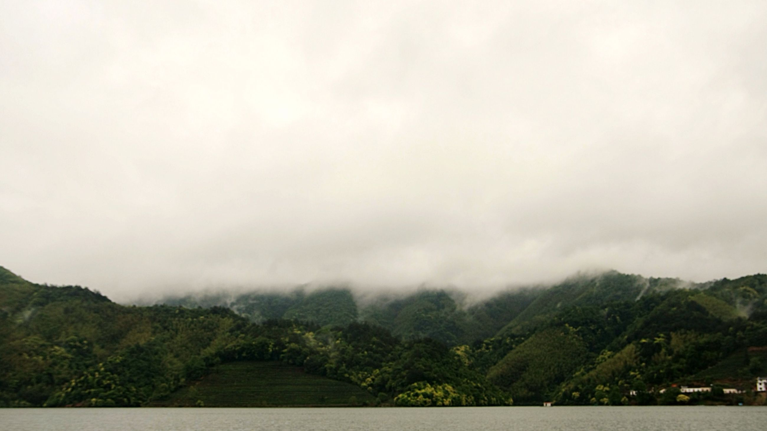 mountain, sky, scenics, tranquil scene, tranquility, beauty in nature, mountain range, tree, nature, cloudy, landscape, cloud - sky, weather, fog, overcast, non-urban scene, idyllic, day, outdoors, cloud