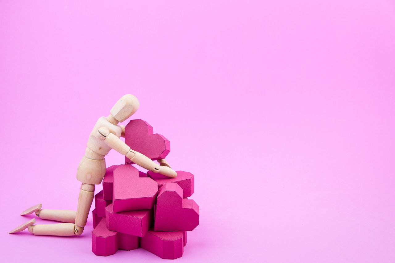 pink color, studio shot, pink background, copy space, doll, no people, close-up, white background