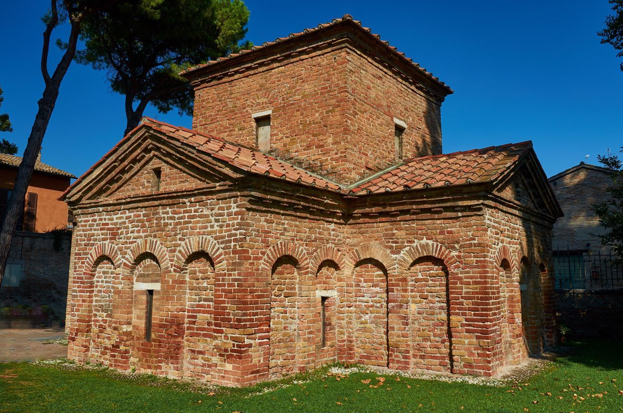 Mausoleo di Galla Placidia, Ravenna Ravenna Italy Mausoleum Mausoleo Di Galla Placidia Tomb Architecture Medieval Medieval Architecture Redbrick Brick Blue Sky Grass Trees No People History Historical Building Historic Built Structure Building Exterior Arches Roof Tiles Red