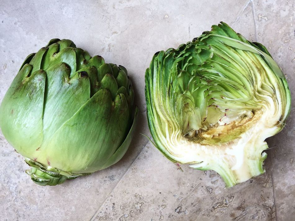 Artichoke cut in half, cleaned and ready to be cooked and eat as a part of a healthy lifestile diet Artichoke Artichokes Cooking Cut Cut In Half Diet Food Food Green Growth Healthy Healthy Eating Healthy Lifestyle Home Cooked Home Cooking Leaf Nature Peal Ready To Cook Ready To Eat Vegetable Vegetarian Food