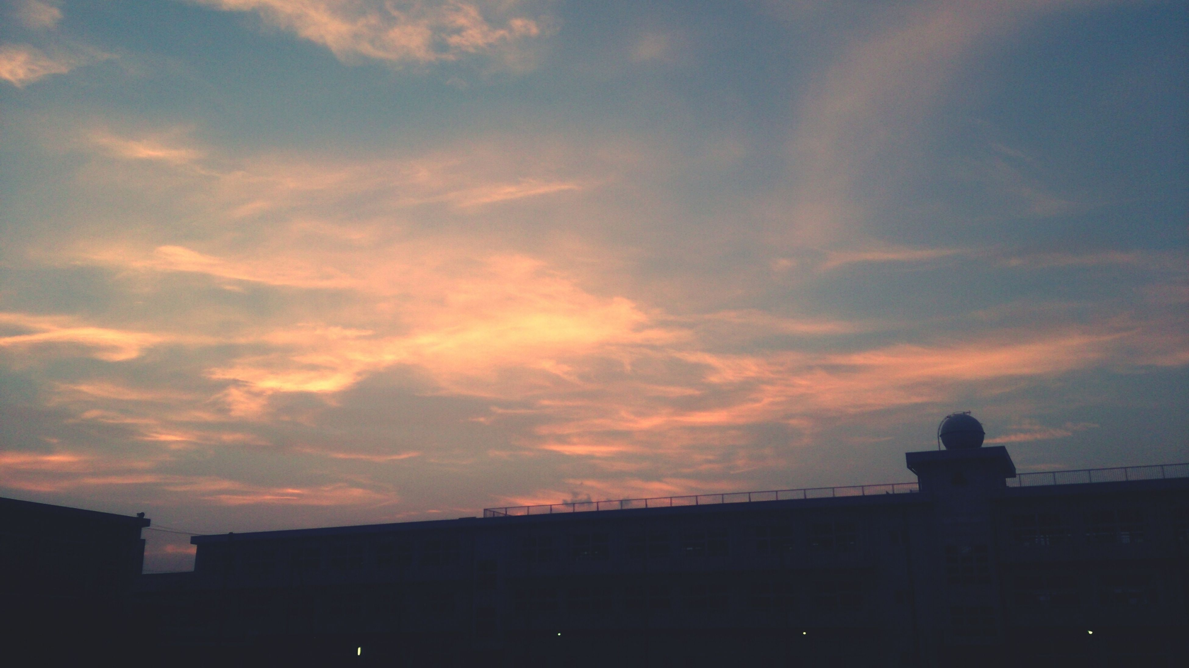 sunset, silhouette, architecture, built structure, building exterior, sky, orange color, cloud - sky, low angle view, cloud, building, dusk, outdoors, city, outline, nature, beauty in nature, dramatic sky, no people, dark