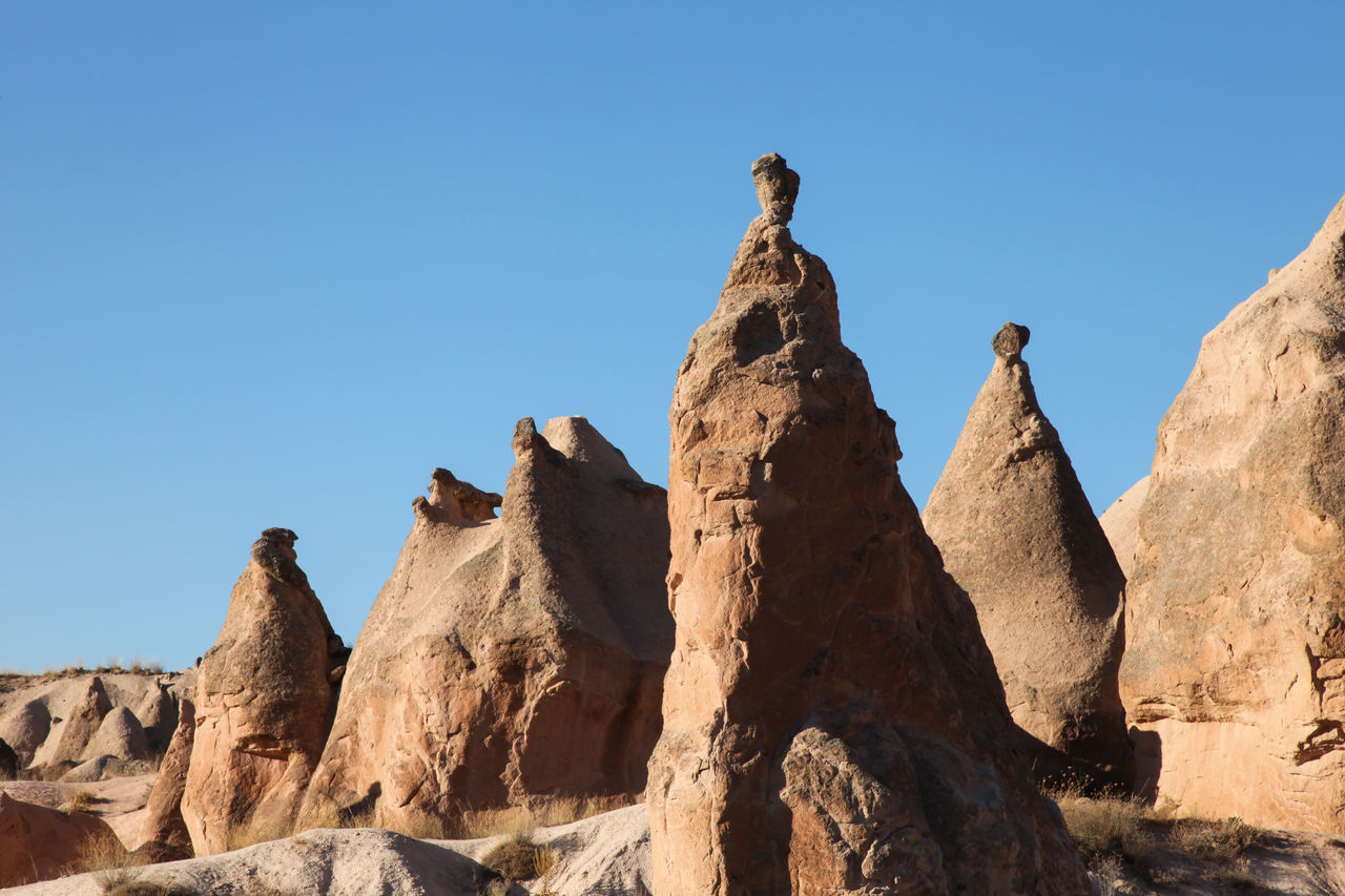 sculpted rock fairy chimneys Beauty In Nature Cappadocia Day Destination Fairy Chimneys Landscape Nature No People Outdoors Rock - Object Sculpted Sky Travel Tufa Turkey