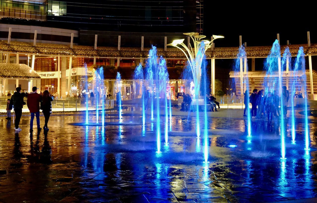 Architecture Color Colorful Colorsplash Colour Of Life Fountain Ice Rink Illuminated Leisure Activity Lifestyles Men Motion New Talents Night Night Photography Outdoors People Real People Sky Travel Destinations Water Water Reflections Water_collection Waterfall Wet