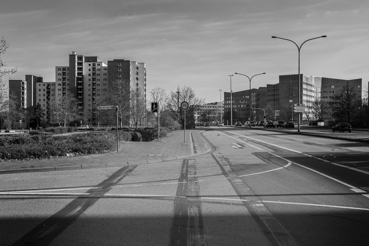 Arterial Road Architecture Arterial Road Building Built Structure City City Life City Street Cloud - Sky Day Dicker Busch Diminishing Perspective Empty Modern No People Office Building Outdoors Road Road Marking Sky Street Light Suburbia Tall - High The Way Forward Vanishing Point