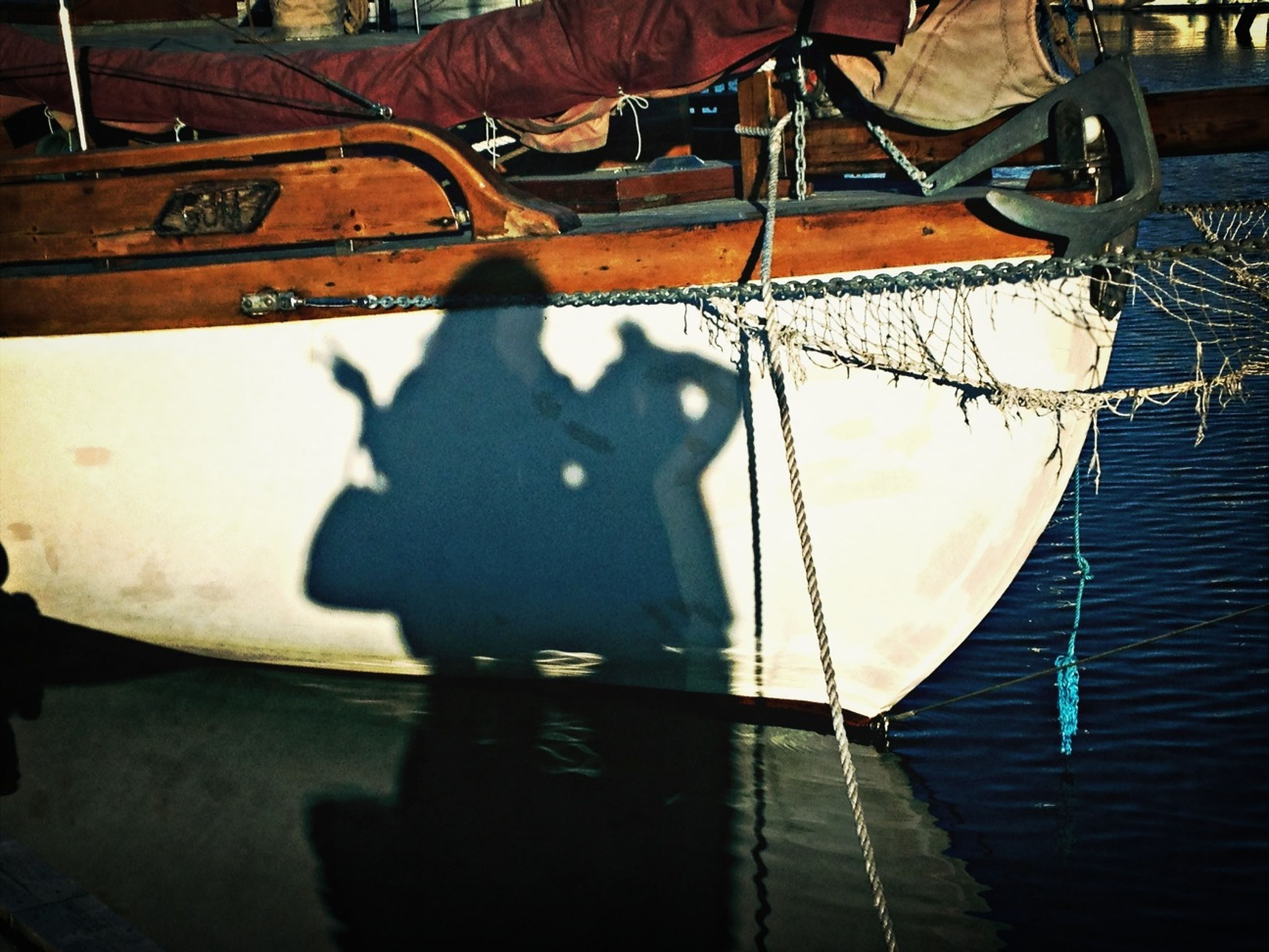 mode of transport, nautical vessel, transportation, water, rope, boat, moored, outdoors, harbor, metal, high angle view, sunlight, protection, day, chain, close-up, no people, safety, reflection, sky