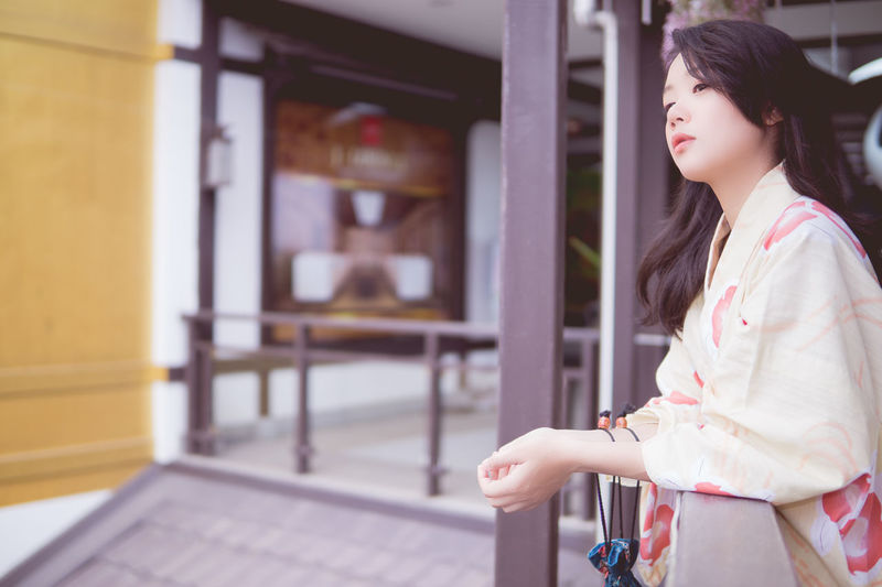 Architecture Beautiful Woman Casual Clothing Day Focus On Foreground Human Hand Kimono Leisure Activity Lifestyles One Person Outdoors People Real People Standing Women Young Adult Young Women