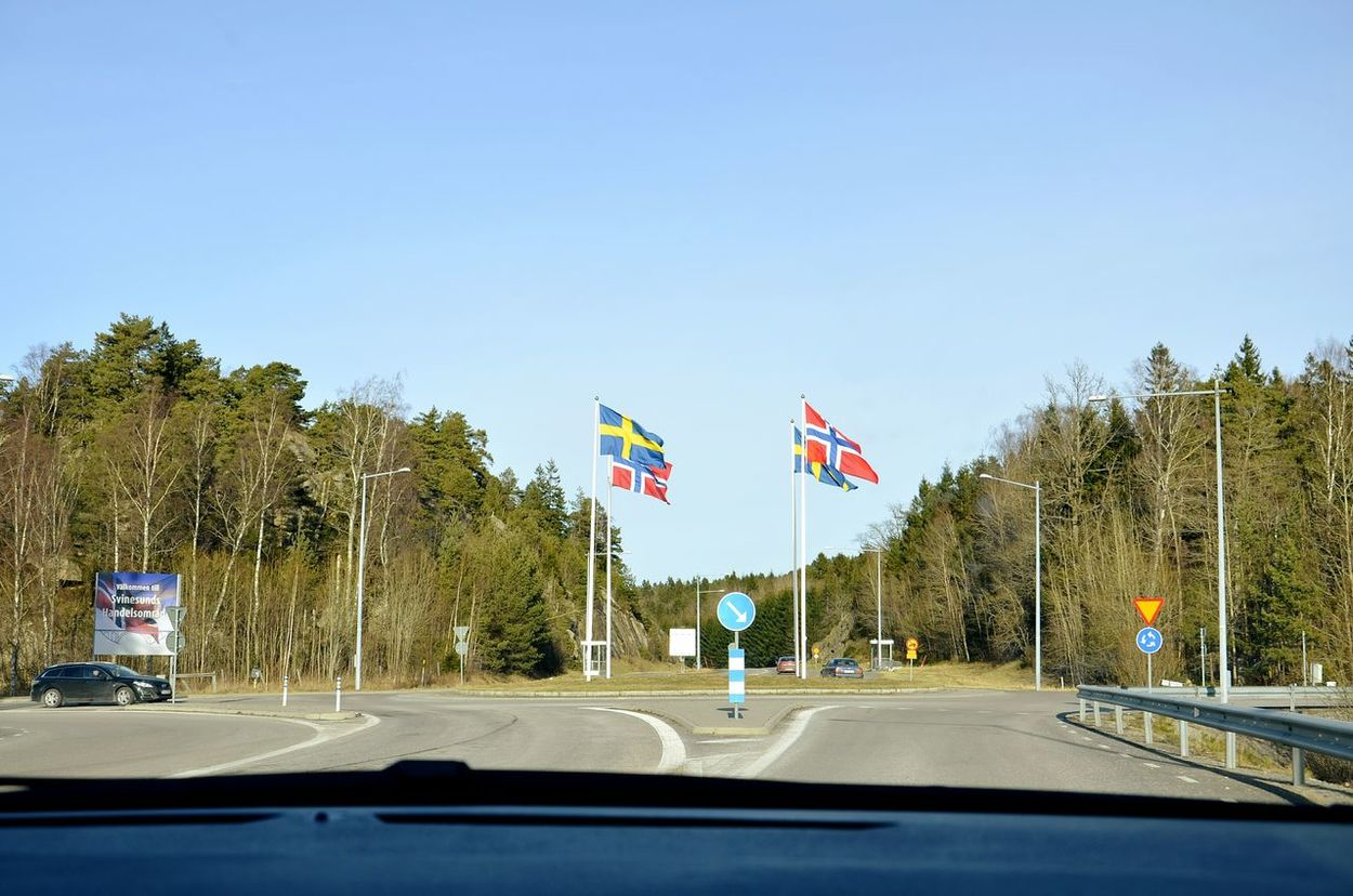Norway-Sweden Geographic Boundary... Traveling On A Holiday On The Road Flags Boundary Road Boundary Holiday Streetphotography