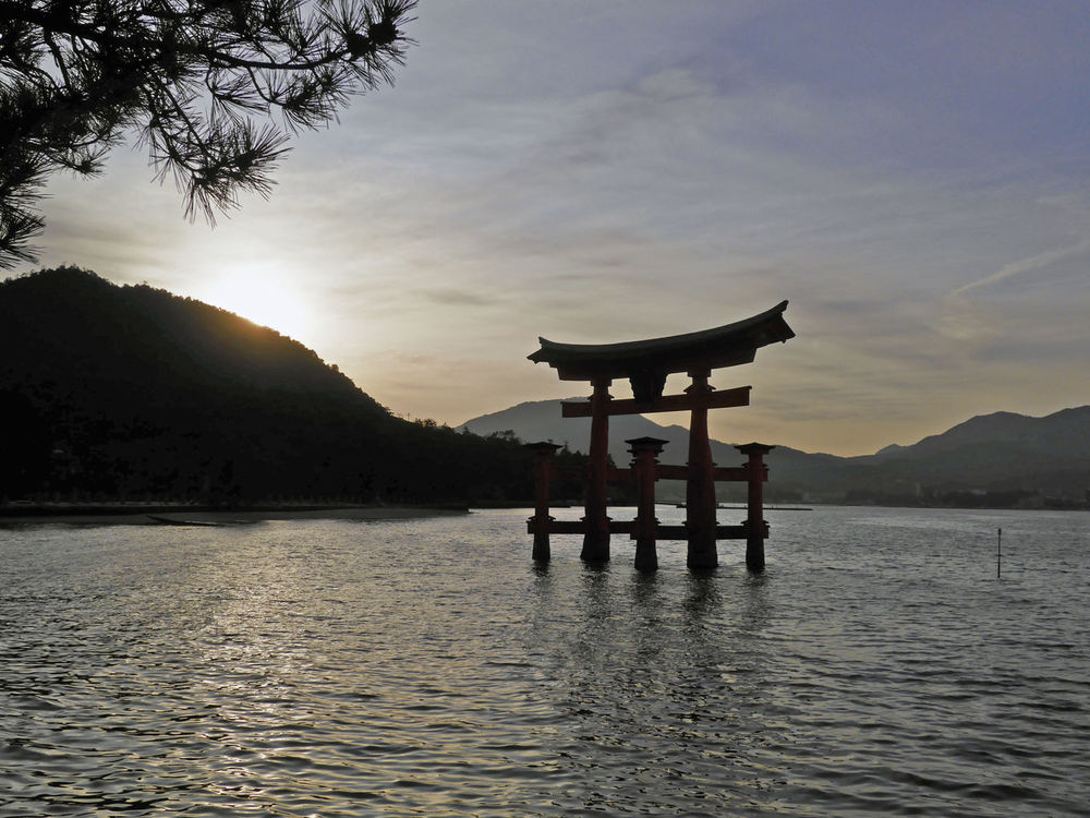 Itsukushima Island, Feb 2016 Beauty In Nature Day Gate Island Japan Japanese  Mountain Nature No People Outdoors Religion Scenics Sea Shinto Shrine Sky Sunset TORII Tranquil Scene Tranquility Water Waterfront