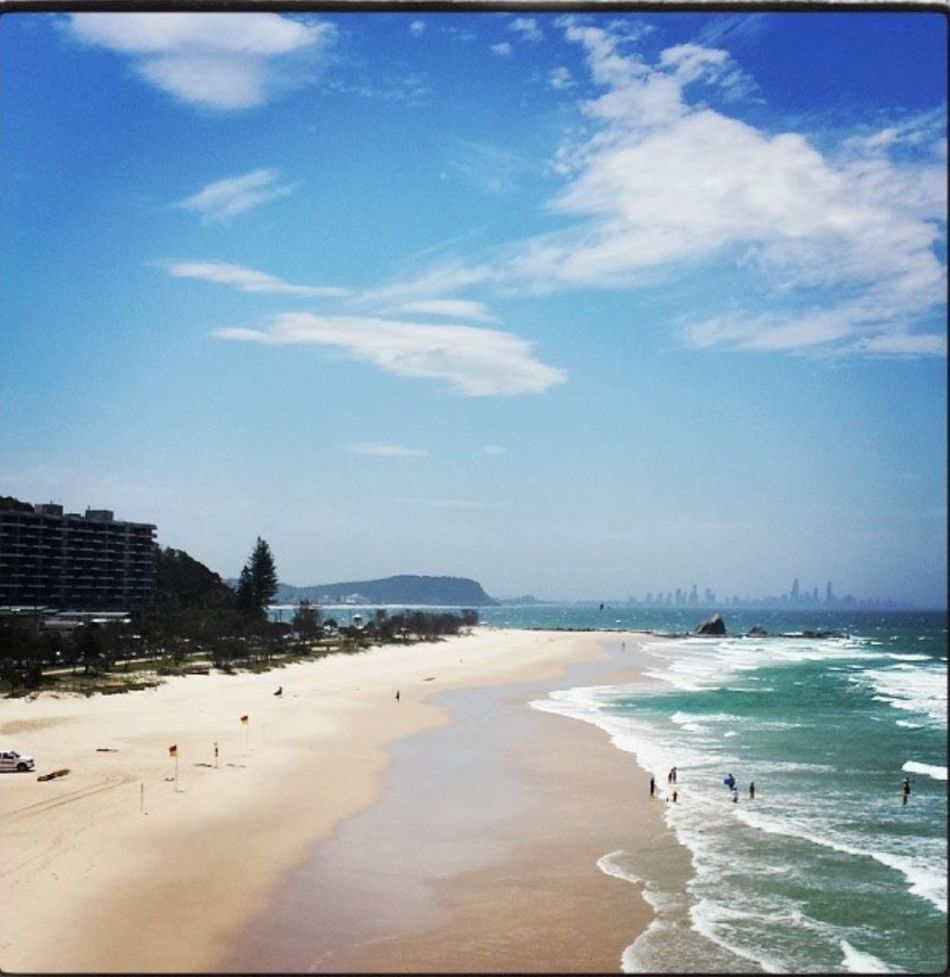 Sea Beach Water Shore Sand Sky Coastline City Blue Vacations Calm Scenics Tranquil Scene Cloud Wave Ocean Tranquility Day Nature Outdoors