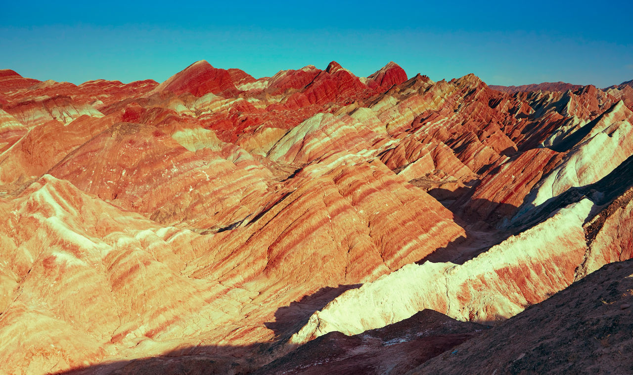 Zhangye Danxia landform in Gansu, China Beauty In Nature Danxia Landform Day Desert Geology Landscape Mountain Nature No People Outdoors Physical Geography Remote Rock - Object Rock Formation Scenics Sky Sunlight Sunset Textured  Tranquil Scene Tranquility Travel Destinations Zhangye