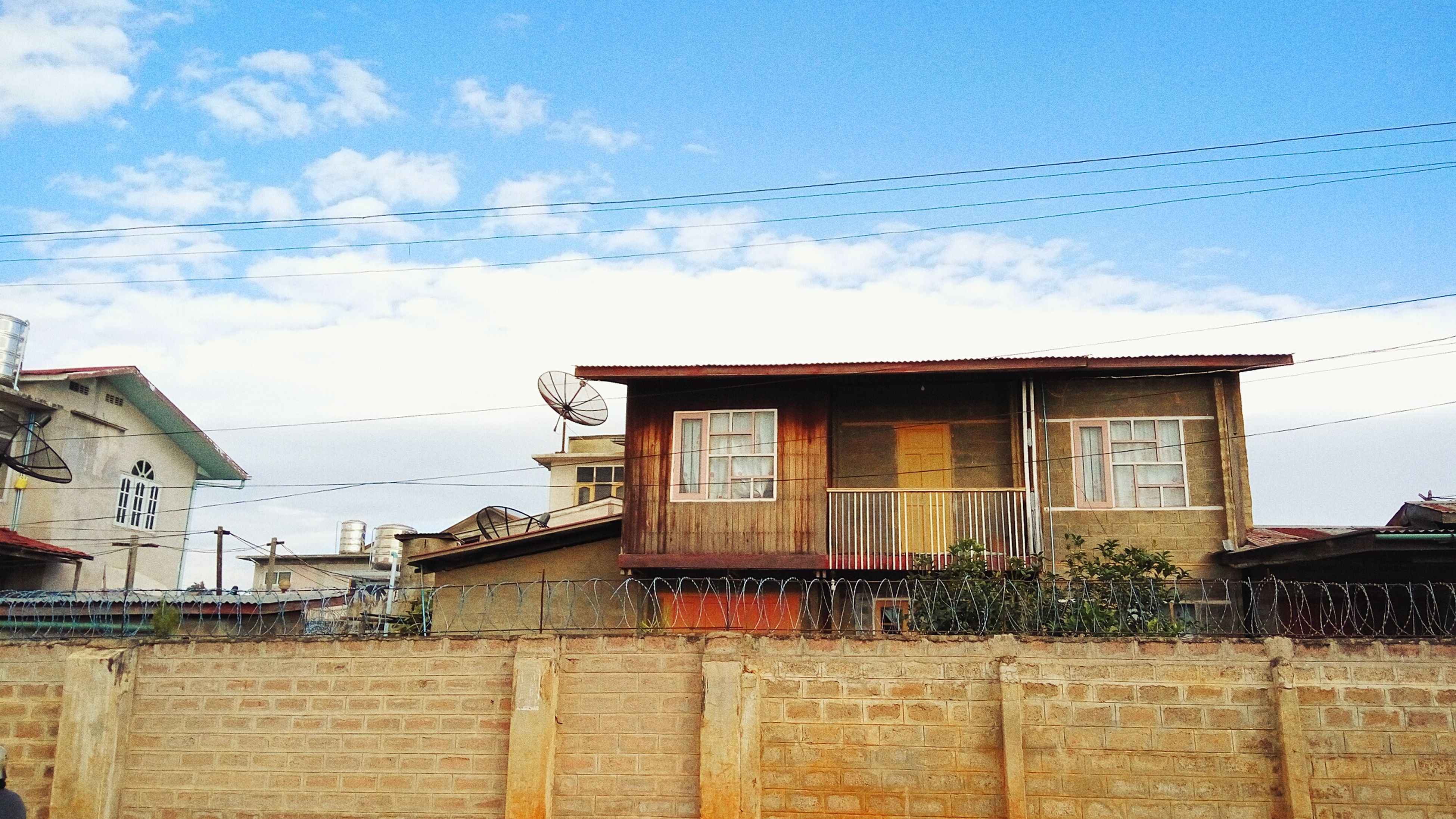 building exterior, architecture, built structure, house, sky, power line, residential structure, cable, residential building, window, roof, day, outdoors, cloud, cloud - sky, no people, electricity pylon, abandoned, old, low angle view