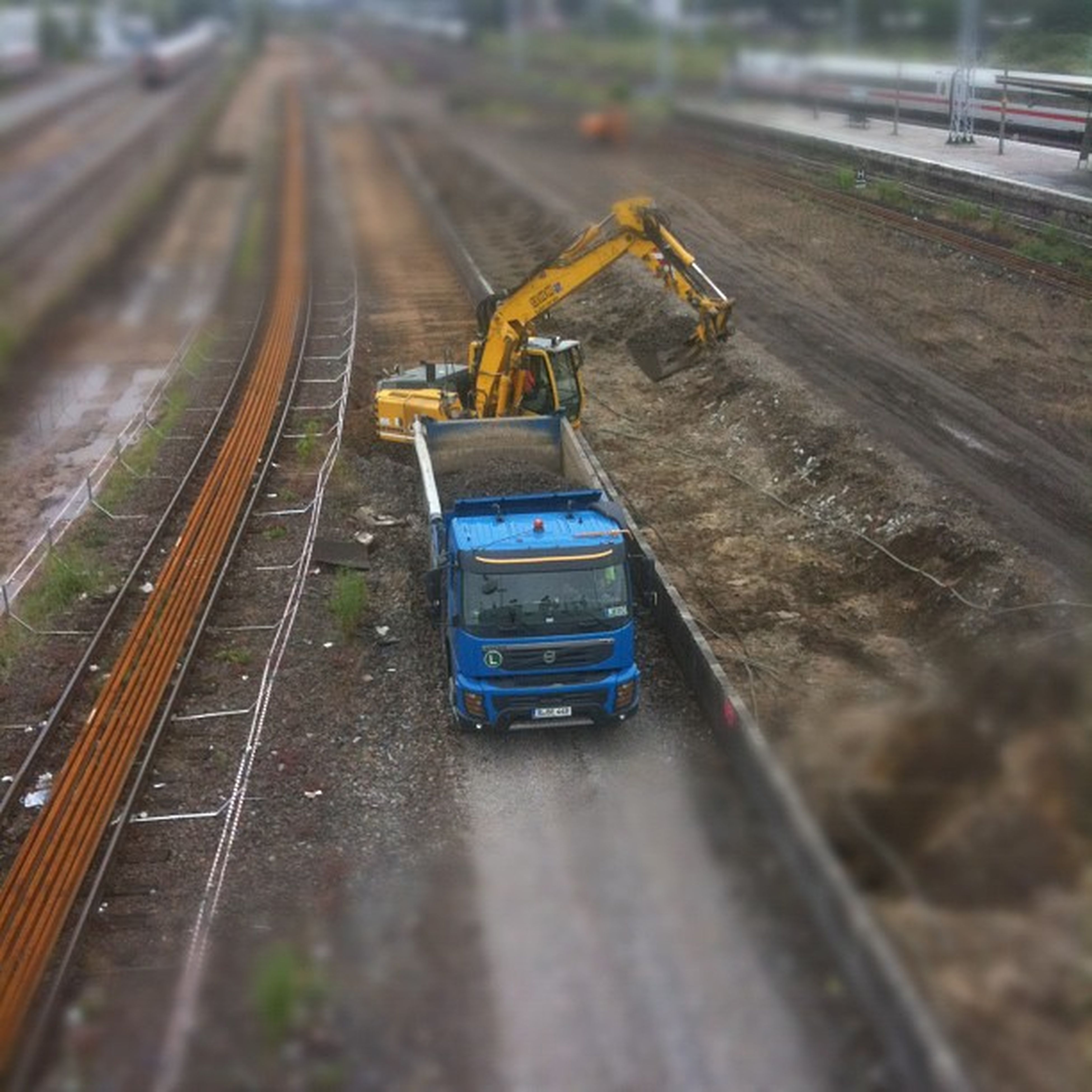 transportation, railroad track, the way forward, diminishing perspective, mode of transport, vanishing point, rail transportation, public transportation, travel, on the move, road, high angle view, land vehicle, road marking, motion, speed, journey, surface level, selective focus, railway track