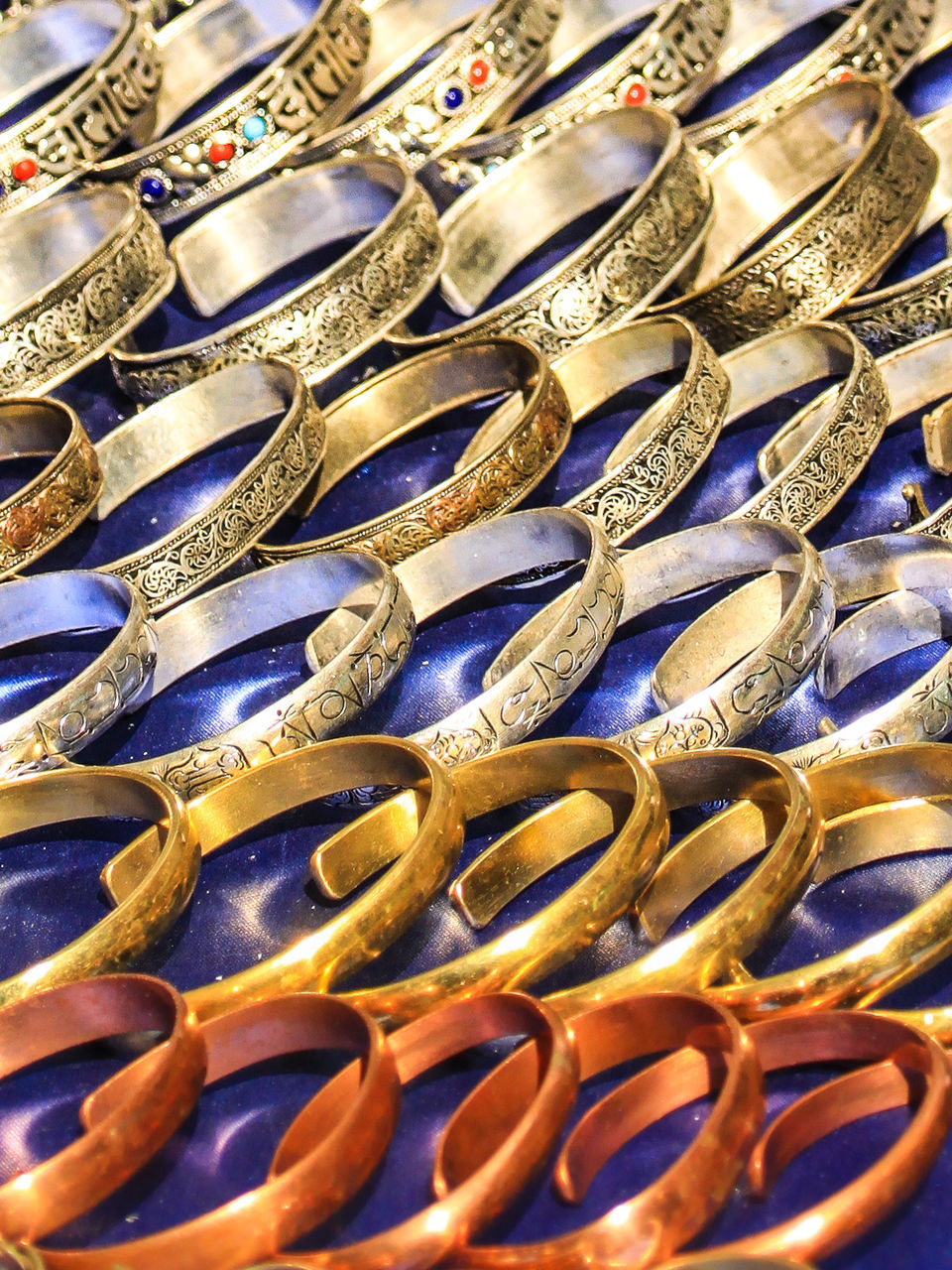 gold colored, gold, large group of objects, no people, full frame, backgrounds, close-up, day, indoors