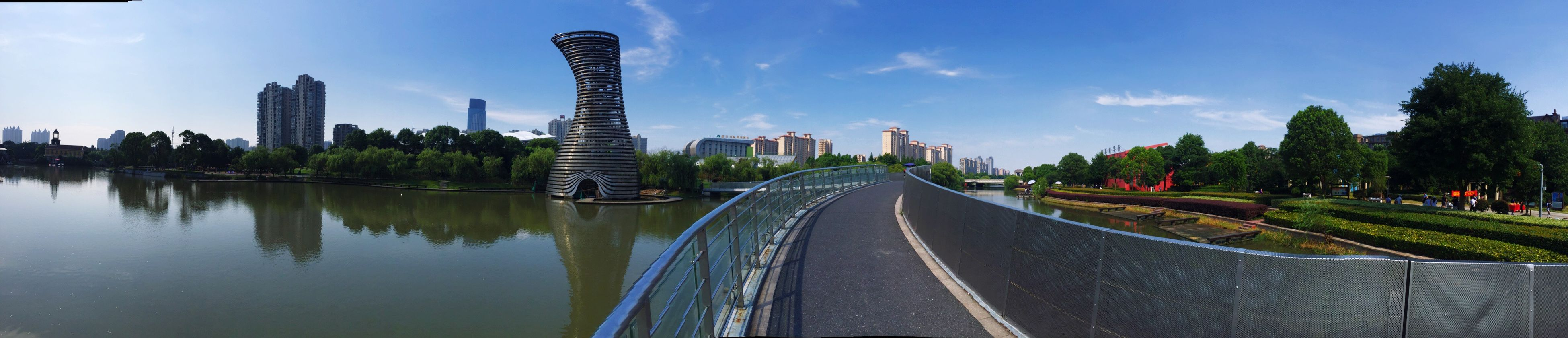 city, architecture, built structure, building exterior, tree, skyscraper, water, sky, outdoors, modern, no people, day, cityscape