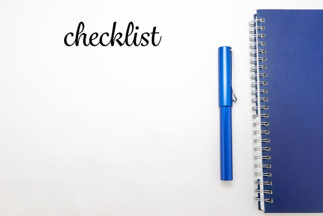 Word Checklist with notebook and pen in white isolated background Action Plan Black Color Blue Checklist Close-up Cut Out Idea Information Isolated White Background No People Notebook NotePad Notes Pen Stationary Still Life Studio Shot White White Background