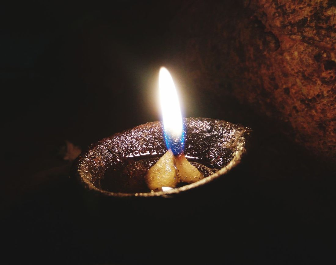 Light it Up... Flame Burning Diwali Diya - Oil Lamp Illuminated Candle Glowing Lighting Equipment Heat - Temperature