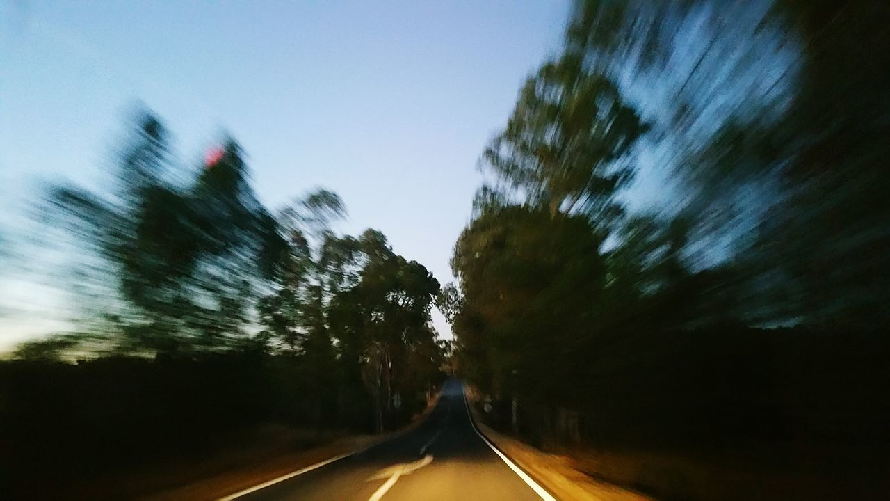 road, the way forward, blurred motion, transportation, motion, tree, speed, no people, outdoors, day, sky, nature, defocused, clear sky
