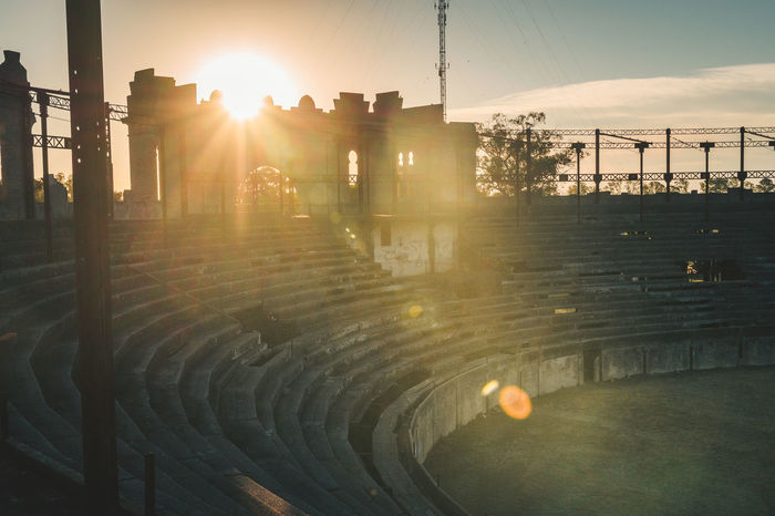 The abandoned bull arena in Colonia. Abandoned Places Arena Historical Building Travel Abandoned Architecture Building Building Exterior Built Structure Bull Arena Bull Ring Electricity Pylon Explore Historic Lens Flare No People Old Outdoors Sun Sunbeam Sunlight Sunset Tree Urban Urbex