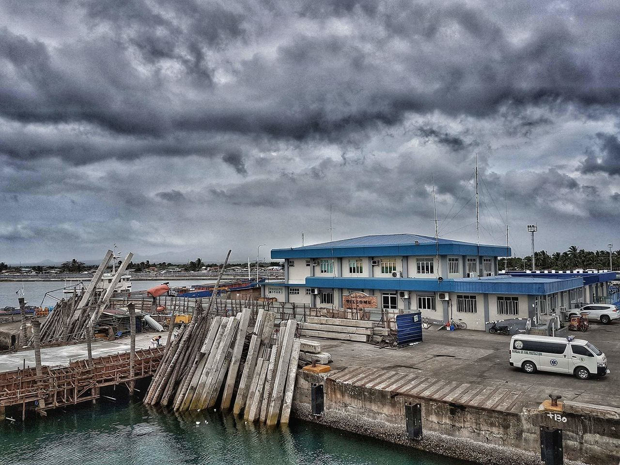 cloud - sky, mode of transport, sky, transportation, nautical vessel, built structure, architecture, building exterior, water, day, outdoors, no people, moored, sea, harbor, nature, commercial dock, storm cloud, city