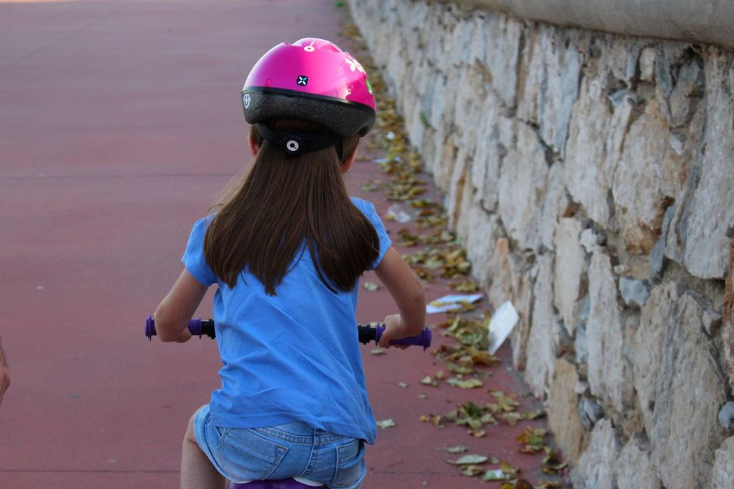 Athleisure Bicycle Child Doughter  EyeEm Best Shots EyeEmBestPics Focus On Foreground From Behind From My Point Of View Girl Helmet Kid Leisure Activity Lifestyles Long Hair Motion Multi Colored My Kid Outdoors Person Personal Perspective Perspective Portrait Riding Bike Wall