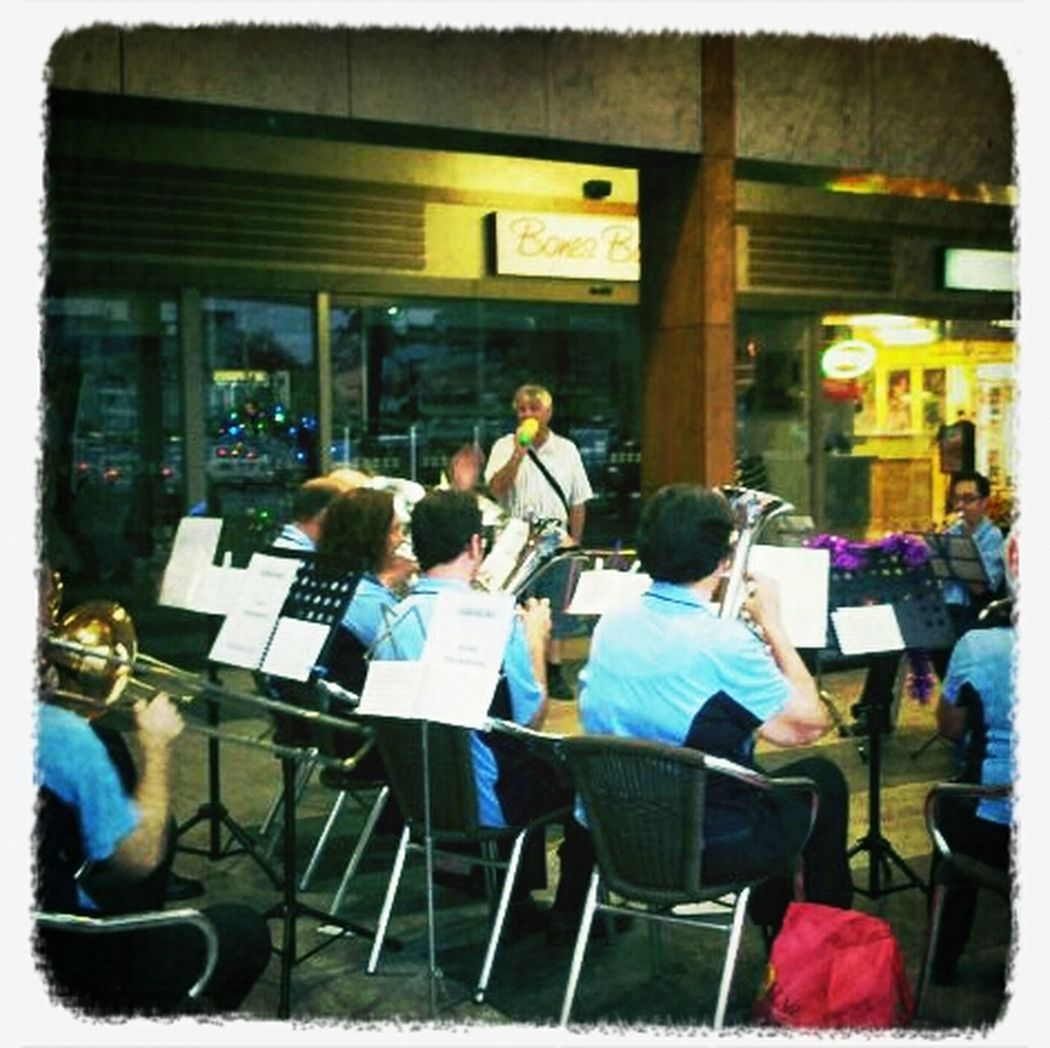Brass band accompanied by a guy with a plastic toy microphone Christmas Spirit